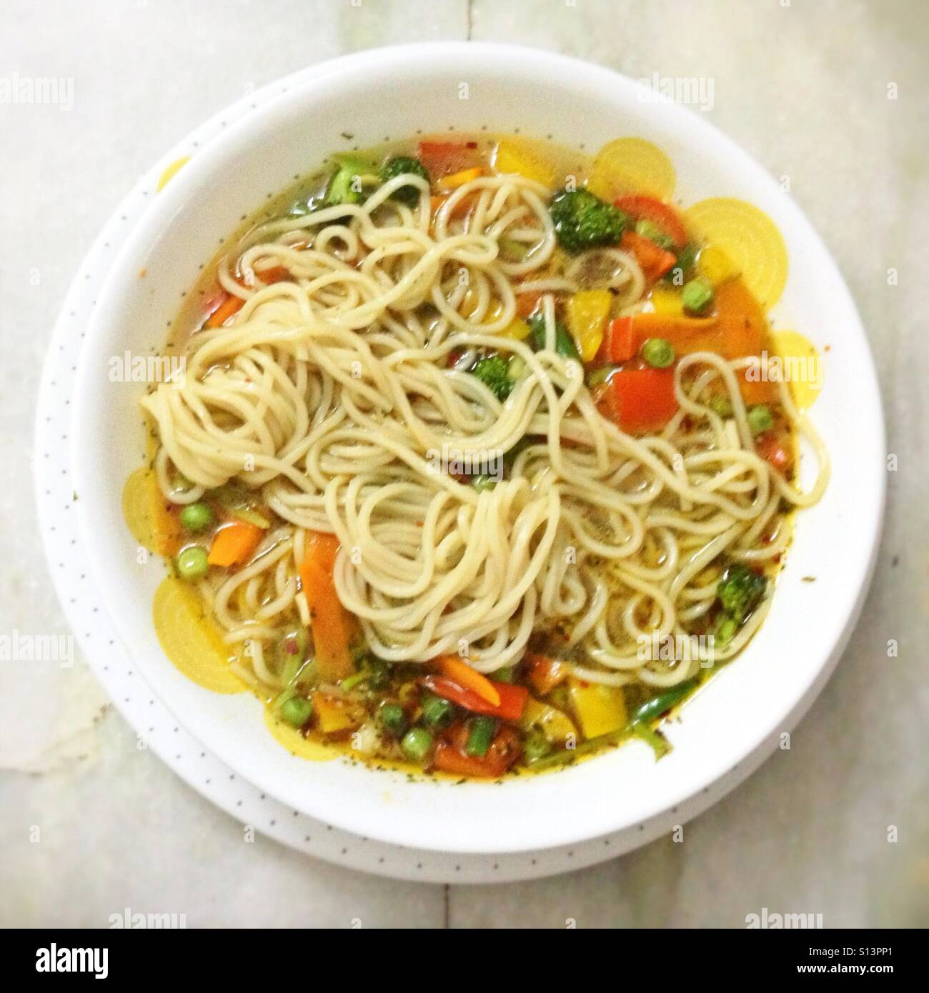 Bowl of Noodles and Vegetables - Stock Image