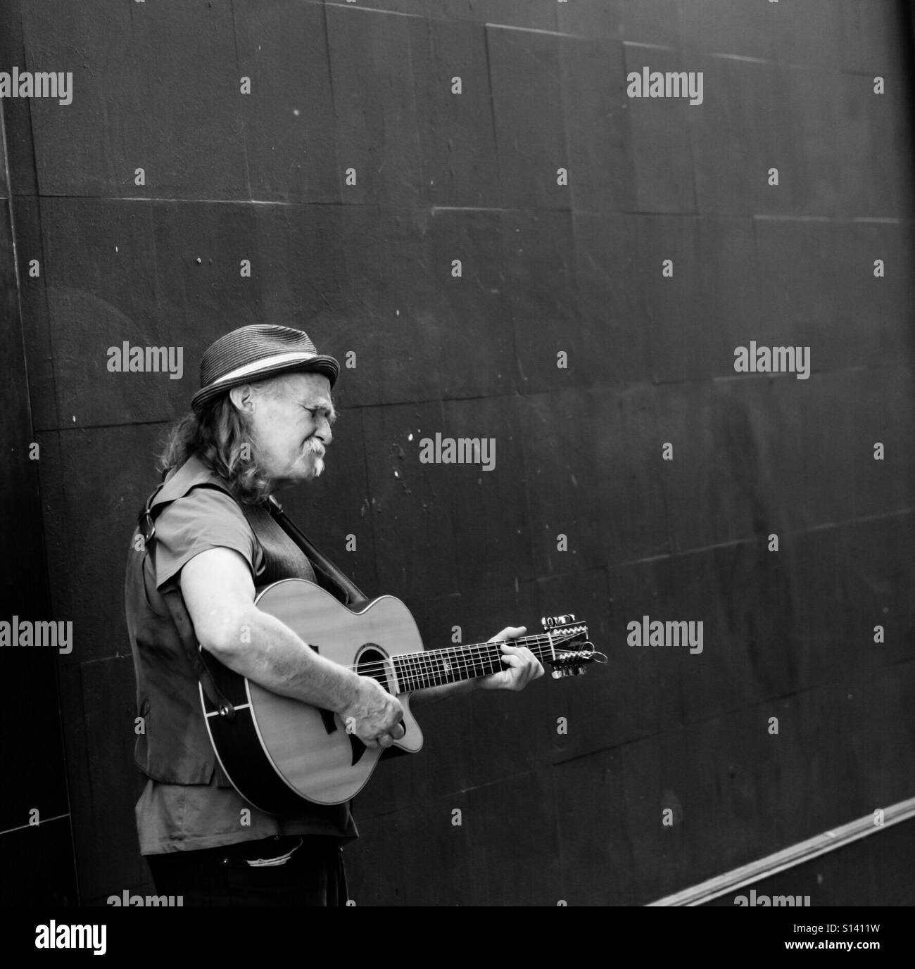 Busker on the streets of  Dublin - Stock Image