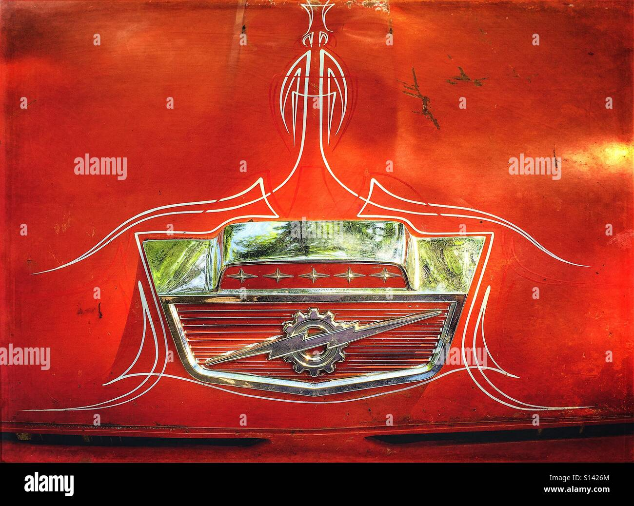 Abstract detail of vintage logo on boot trunk of antique Ford car. - Stock Image