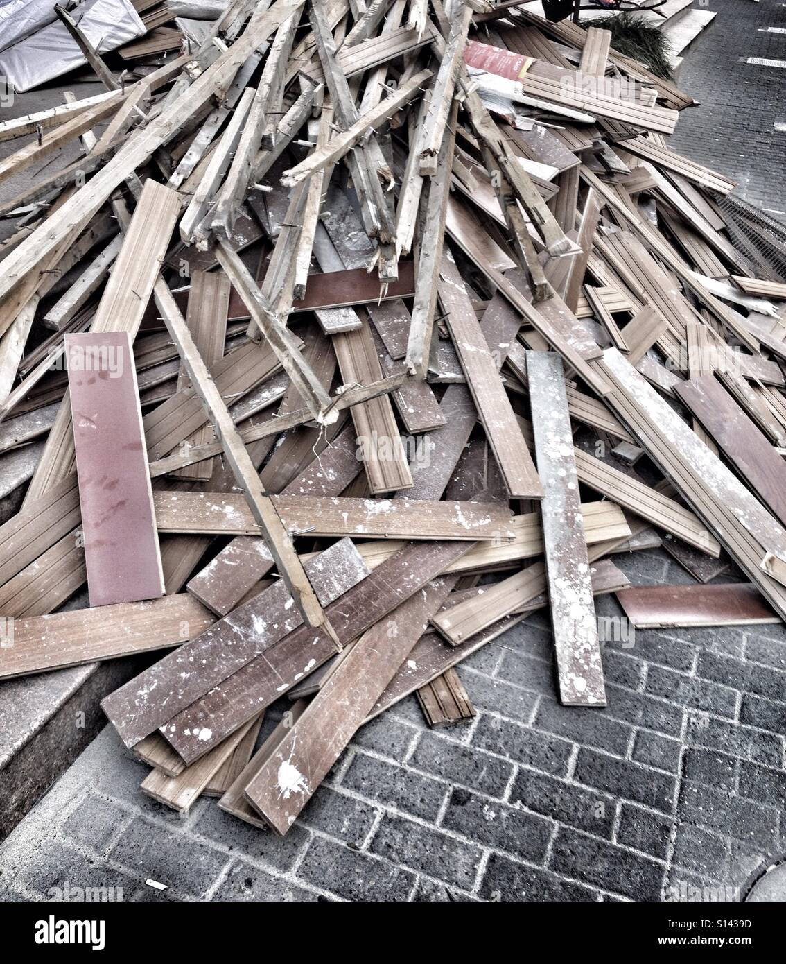 Massive Pile Of Broken Wooden Planks & Wood Blocks At Store Construction Site Lying On The Pavement - Stock Image