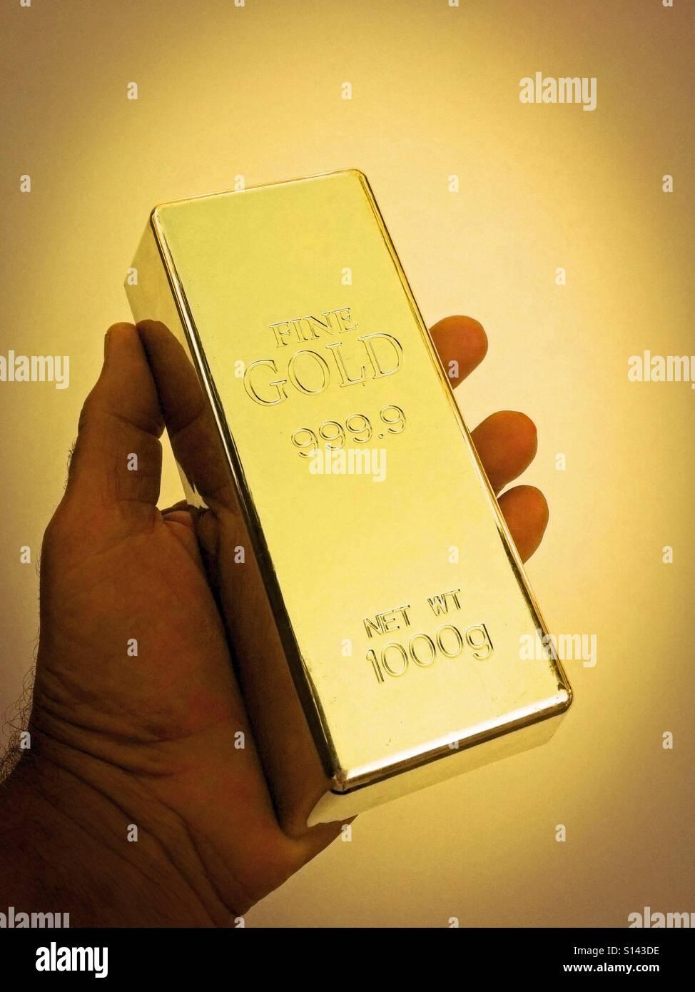 Gold ingot. - Stock Image