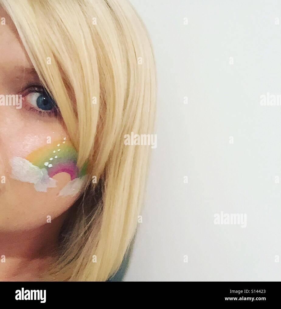 Rainbow facepaint - Stock Image