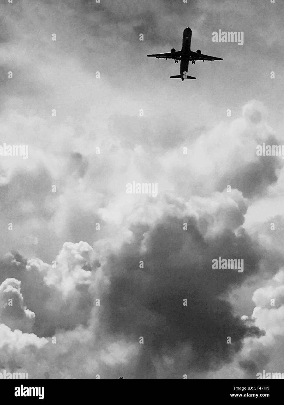 Jet plane amongst the clouds - Stock Image