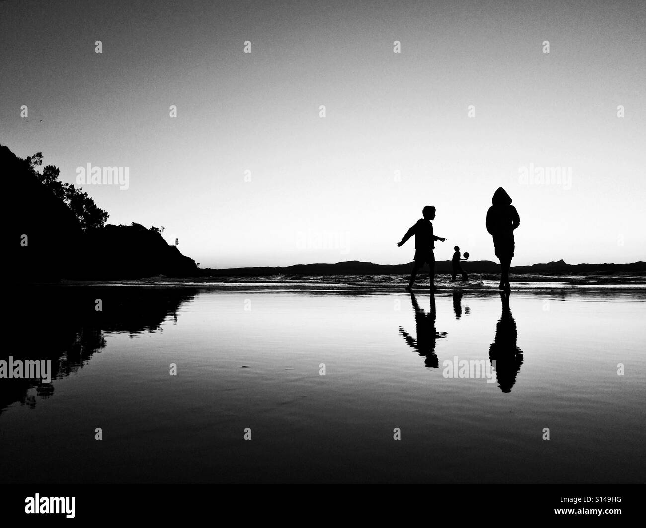 Playing on the Beach - Reflections - Stock Image