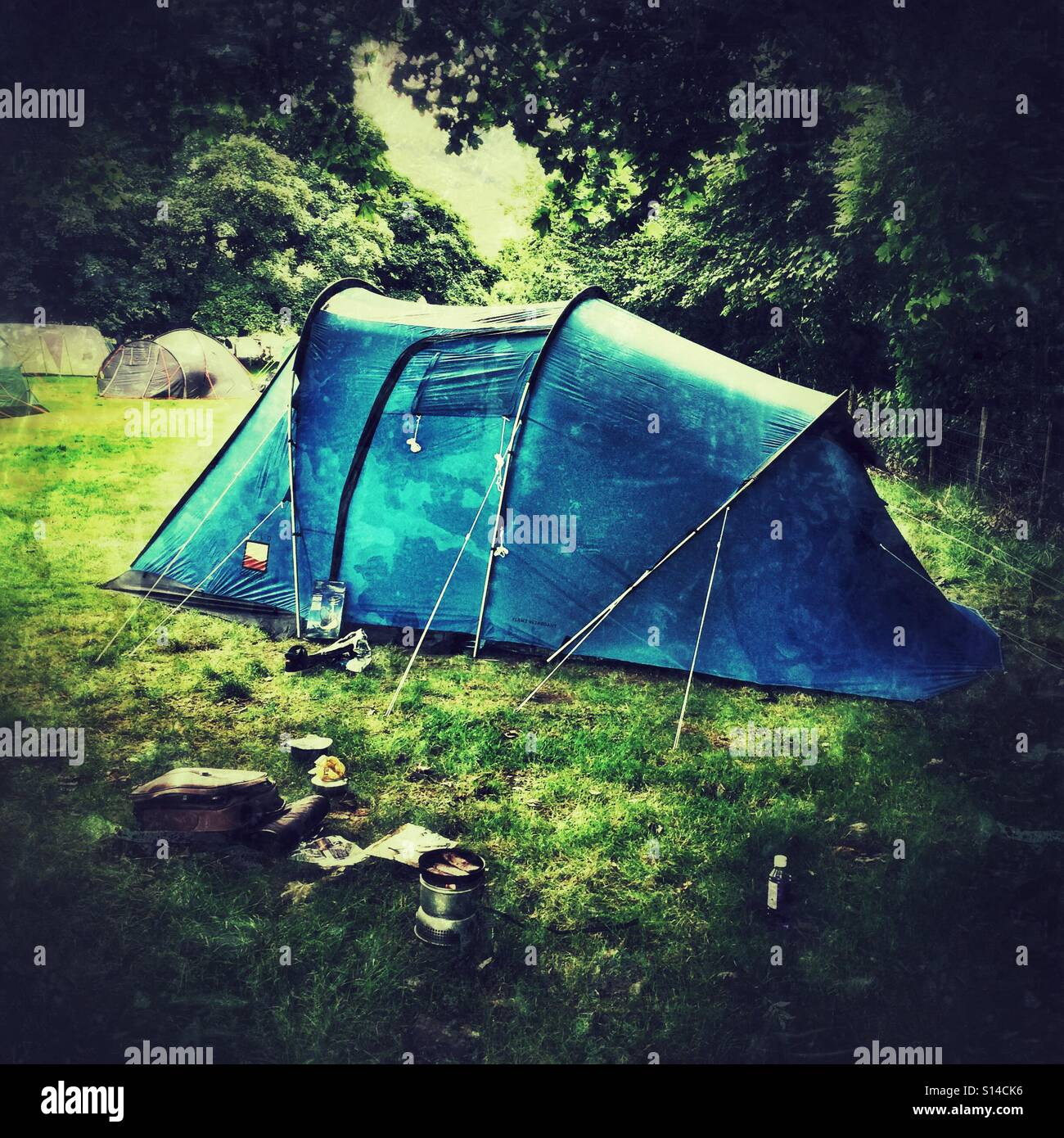 A tent in a field - Stock Image