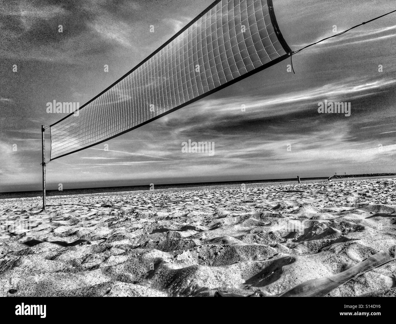 Beachvolleyball grid on a beach - Stock Image