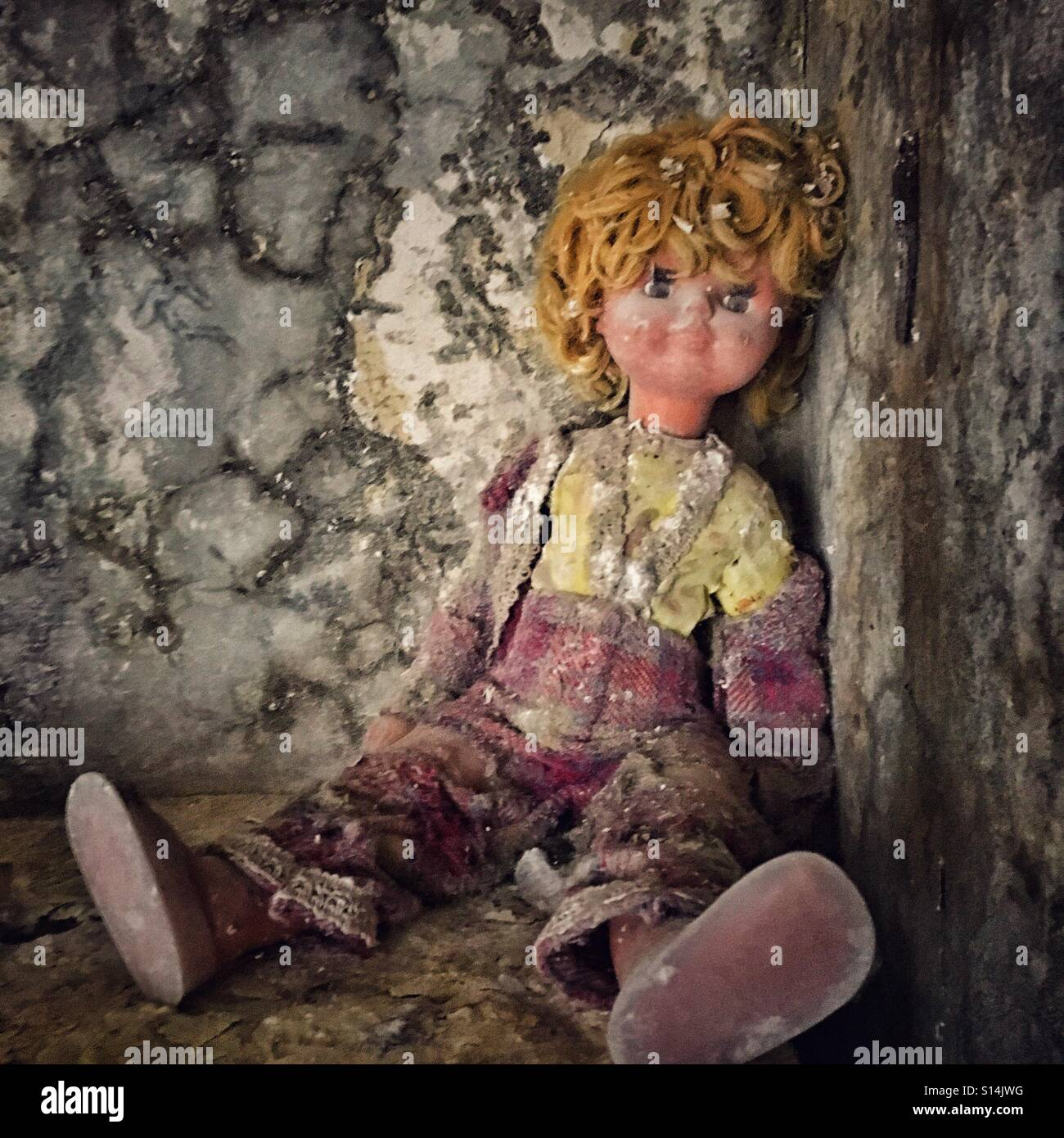 Old doll in abandoned kindergarten in Pripyat ghost town, Chernobyl Nuclear Power Plant Zone of Alienation, Ukraine - Stock Image