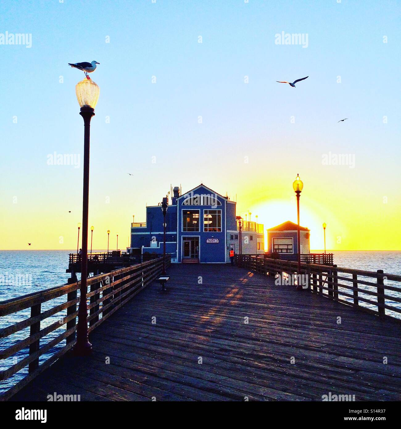 Sunset at the pier. - Stock Image