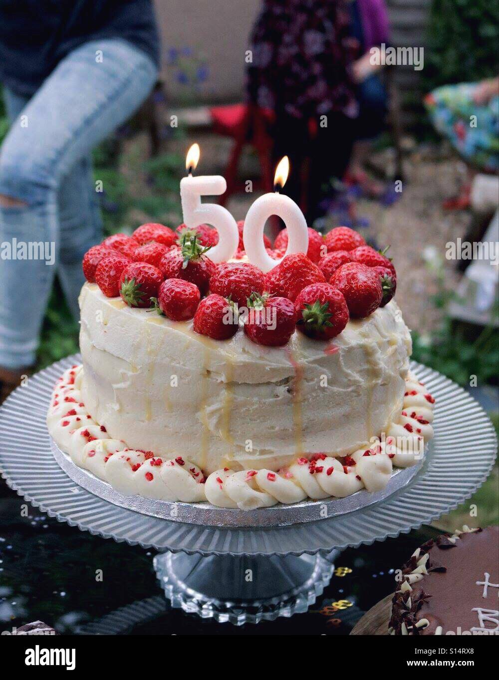 50th Birthday Cake Topped With Strawberries And Candles