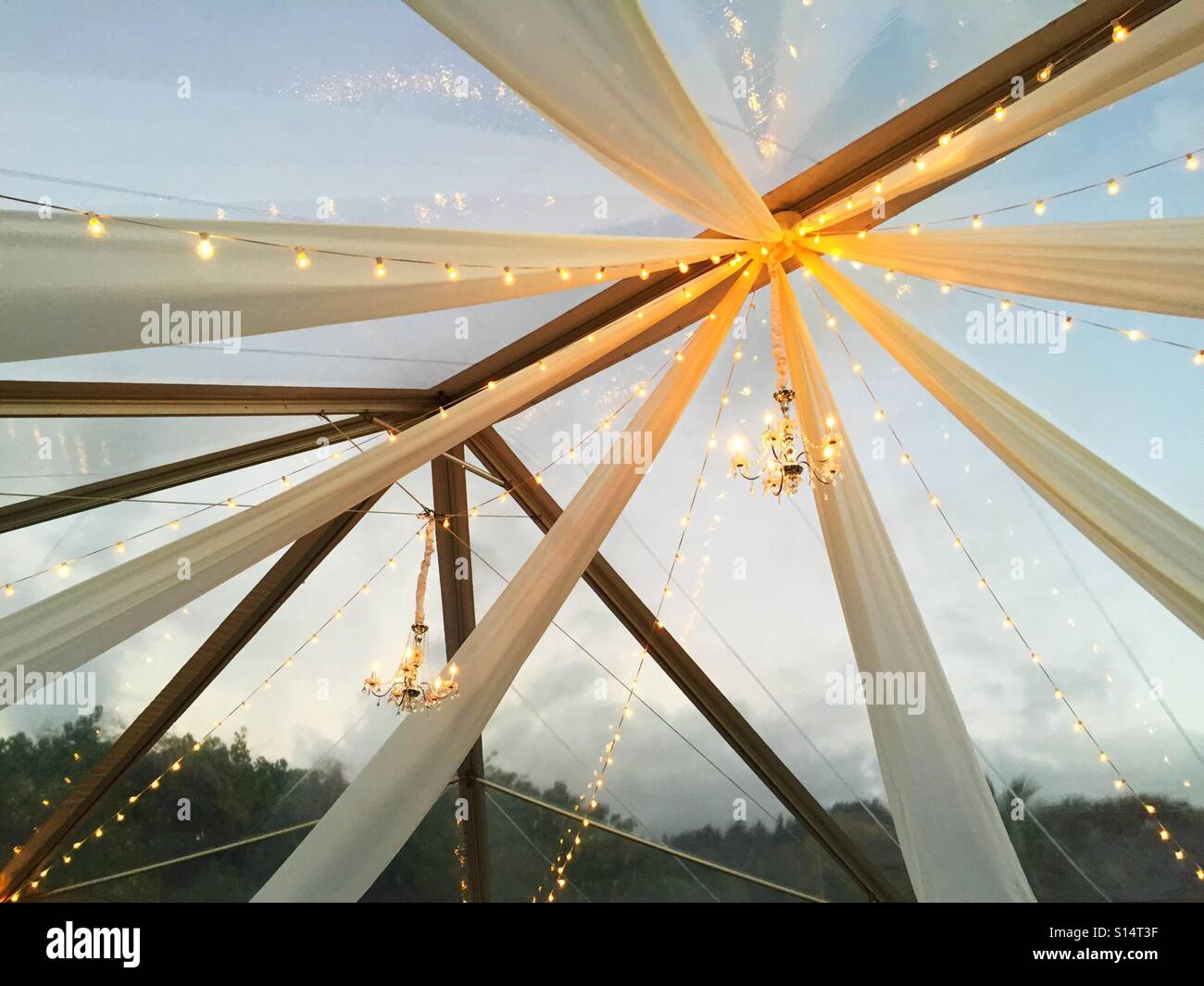 Streamers and chandelier at a wedding - Stock Image