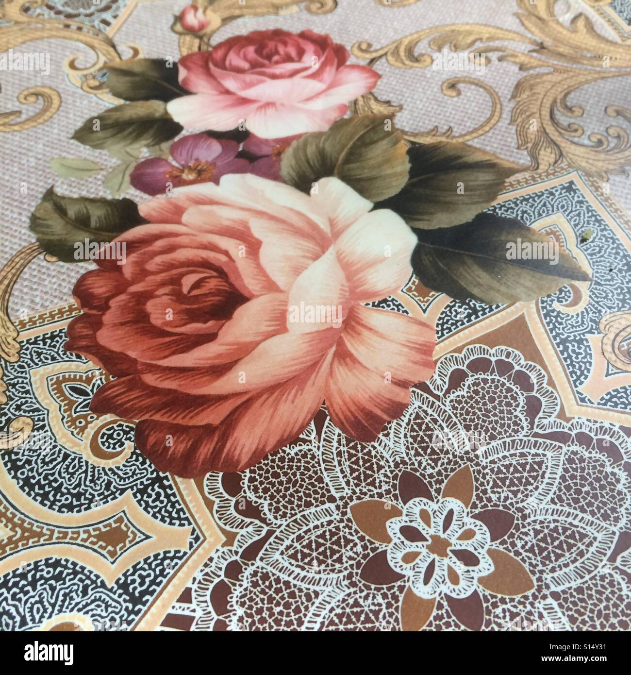 A table cloth showing roses - Stock Image