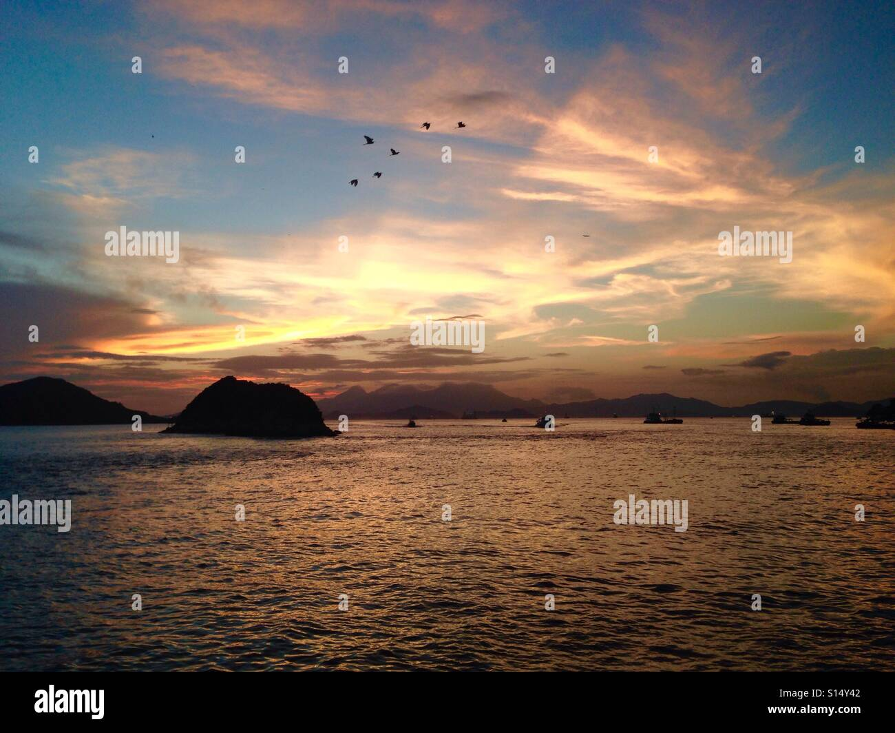 Beautiful sunset over the South China Sea in Hong Kong. Stock Photo