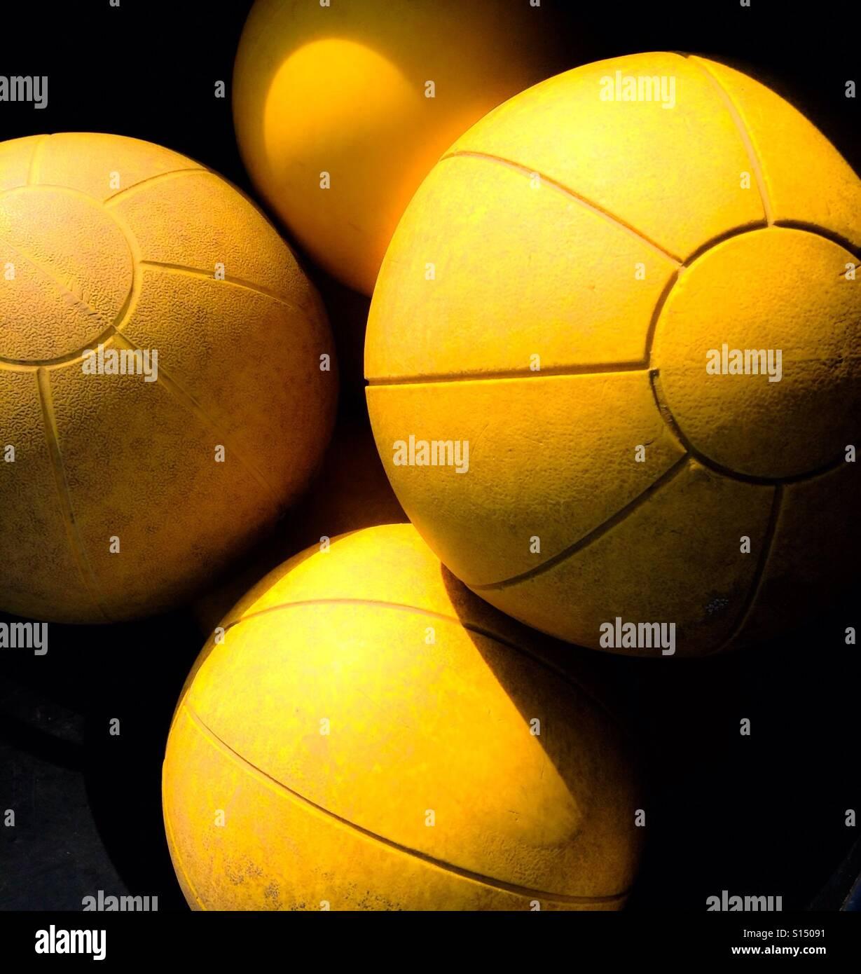 Yellow medicine balls - Stock Image