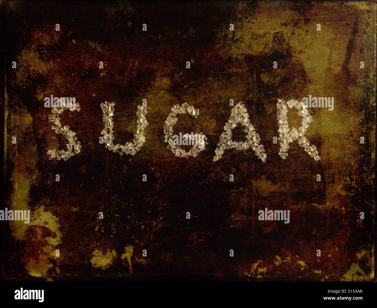 The word sugar written with sugar crystals - Stock Image