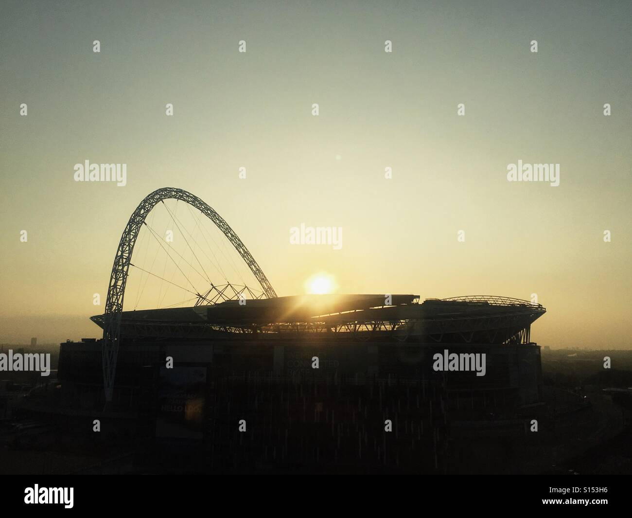 Sunrise over Wembley Stadium. - Stock Image