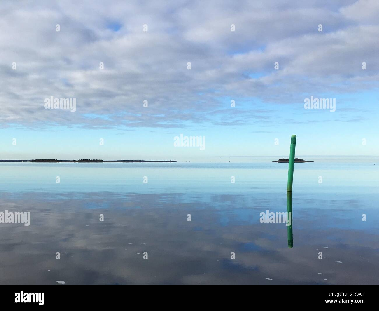 Mirror calm Sea in the autumn morning in Oulu. - Stock Image