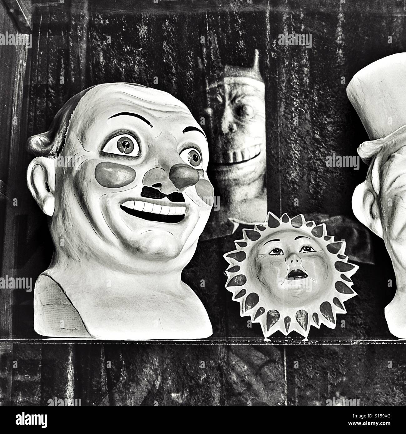 Traditional papier mache head in magic shop window - Stock Image