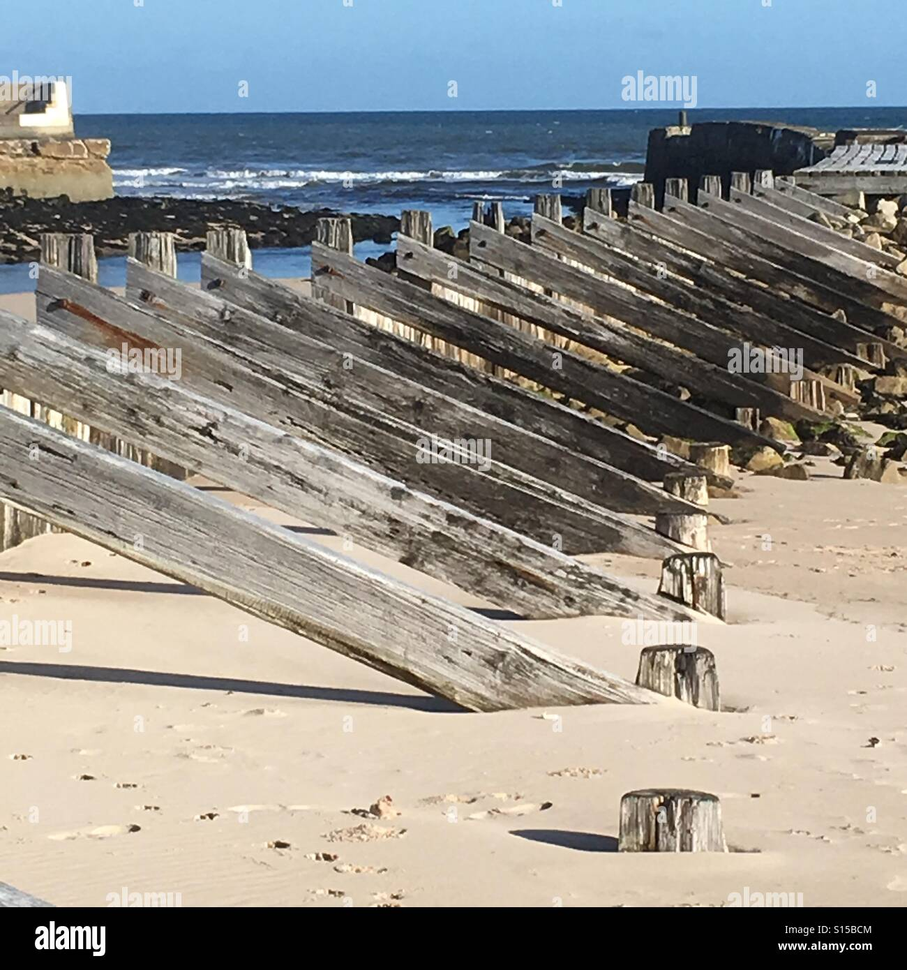 Groynes on Lossiemouth beach, Scotland - Stock Image