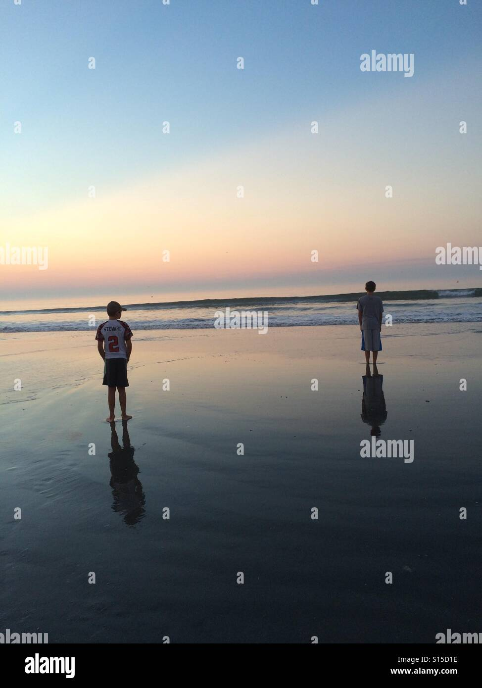 Brothers watching sunrise 2016, Wildwood, NJ, #2 is youngest brother who is cancer survivor for 5 years now - Stock Image