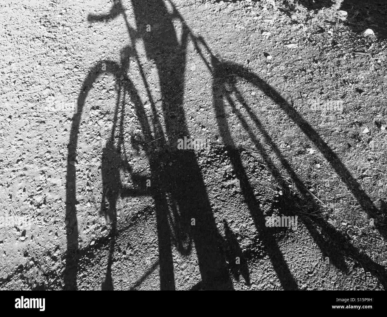Bike shadow - Stock Image