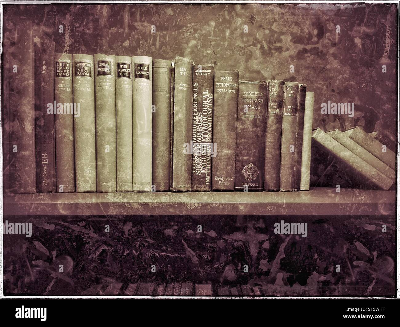 An antique effect image of a selection of hardback books that sit on shelves in a long forgotten room. Photo Credit - Stock Image