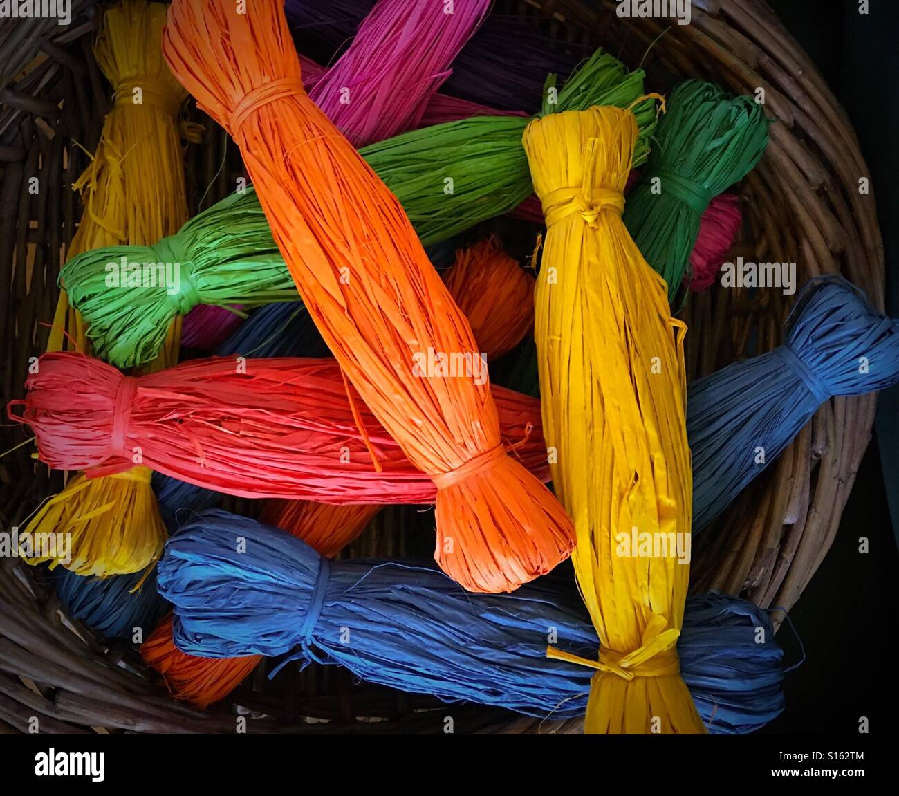 Colourful skeins of raffia - Stock Image