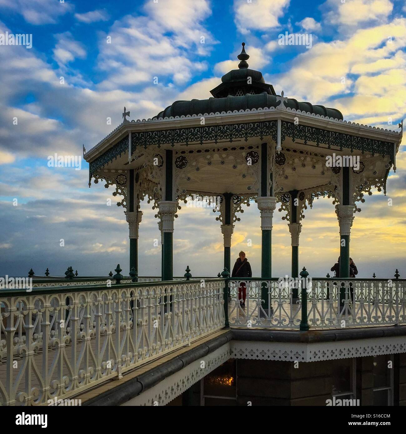 Old bandstand overlooking Brighton beach during sunset - Stock Image