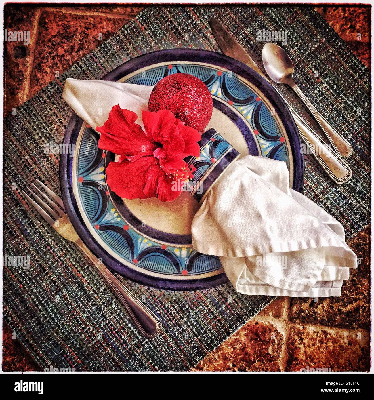 A Holiday Place Setting With A Fresh Red Hibiscus Flower And A Stock Photo Alamy