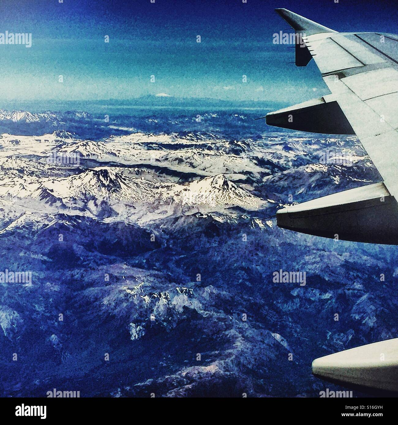 Flying alongside the Cordillera de los Andes snow-capped mountain range, south from Santiago, Chile - Stock Image