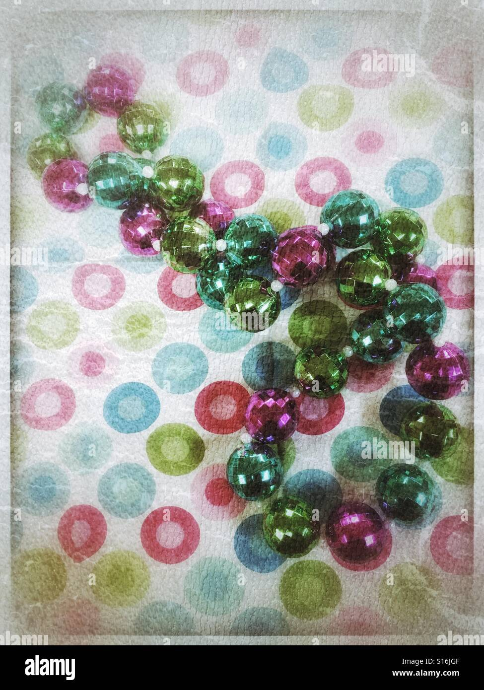 Beads on cloth - Stock Image
