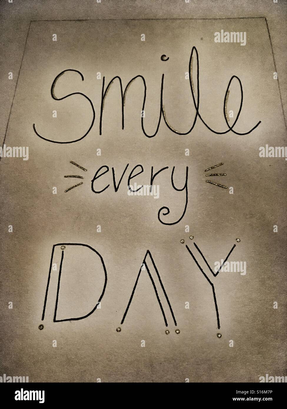 Handwritten 'smile every day' caption in multiple fonts - Stock Image