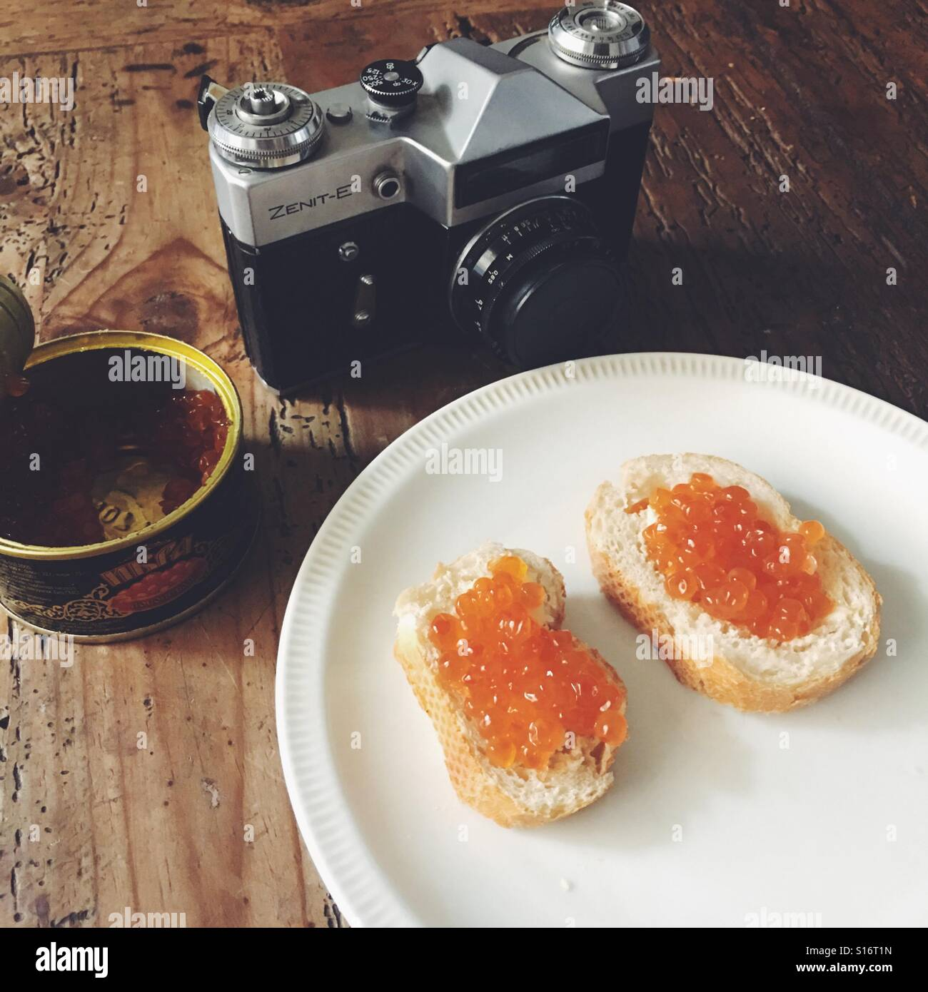 Caviar and old soviet camera Russian style - Stock Image