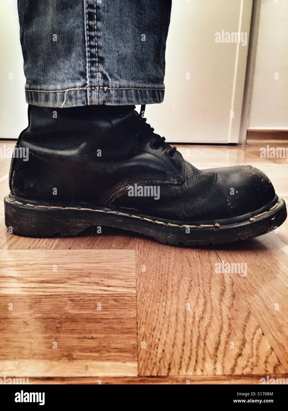 Closeup of man's boot. - Stock Image