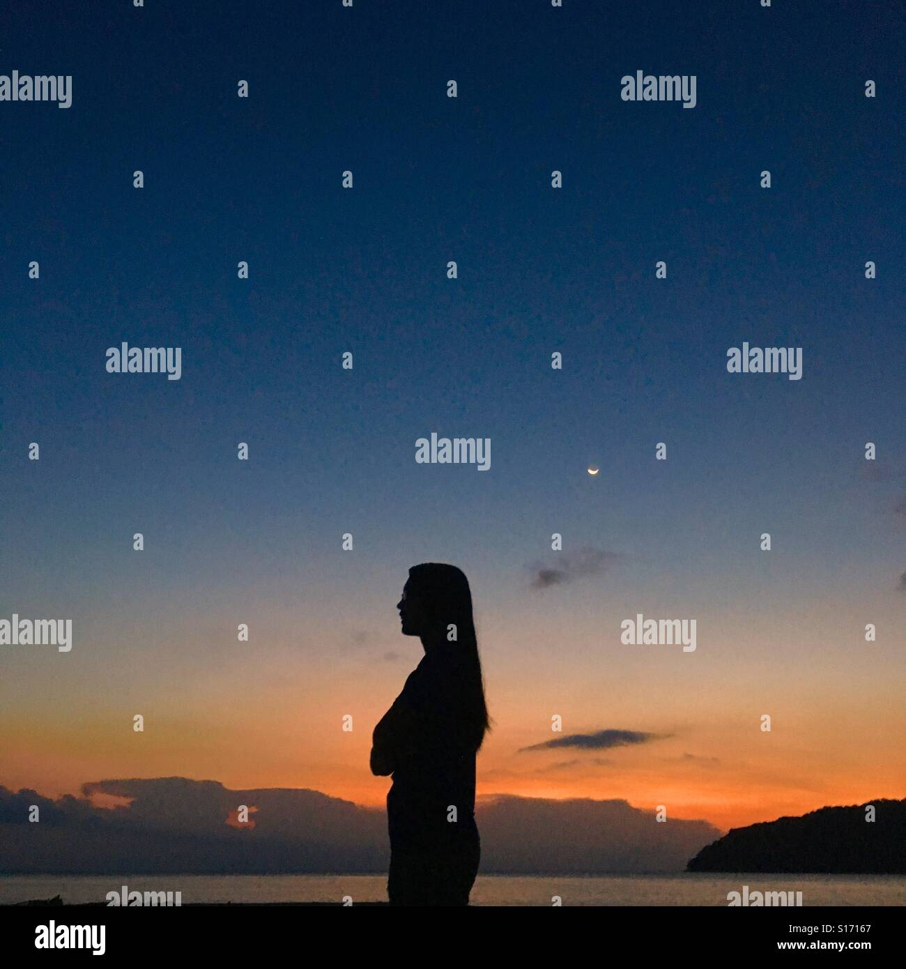 Silhouette of the sunset - Stock Image