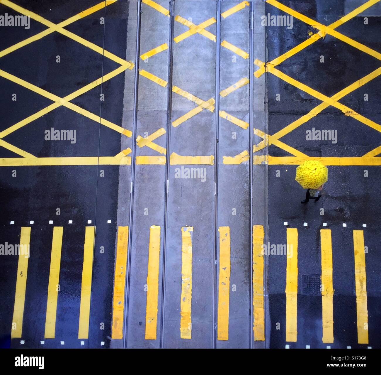 Yellow umbrella and yellow lines - Stock Image