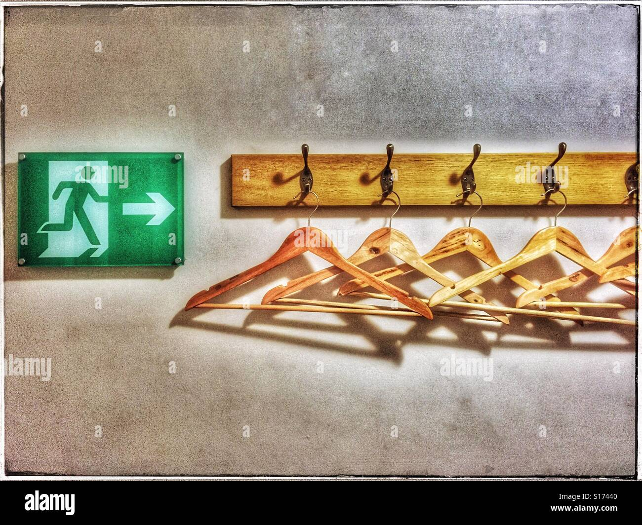 'In the unlikely event of an emergency evacuation, do not stop to collect your personal belongings. Instead, - Stock Image