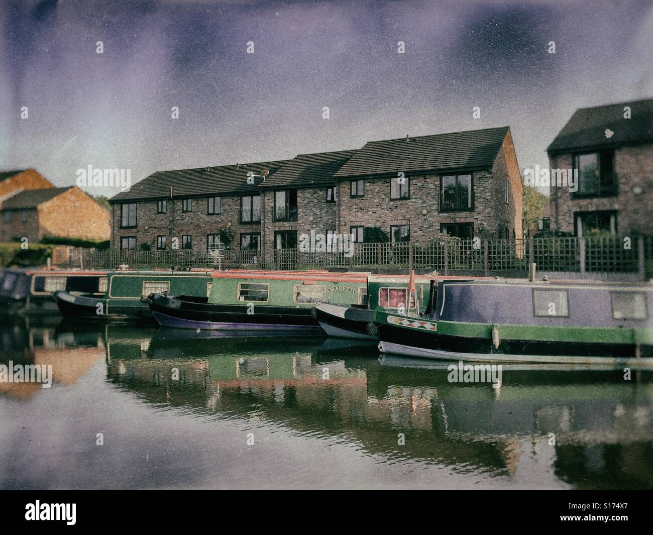 Narrowboats on the Bridgewater Canal in Lymm, Cheshire, UK - Stock Image