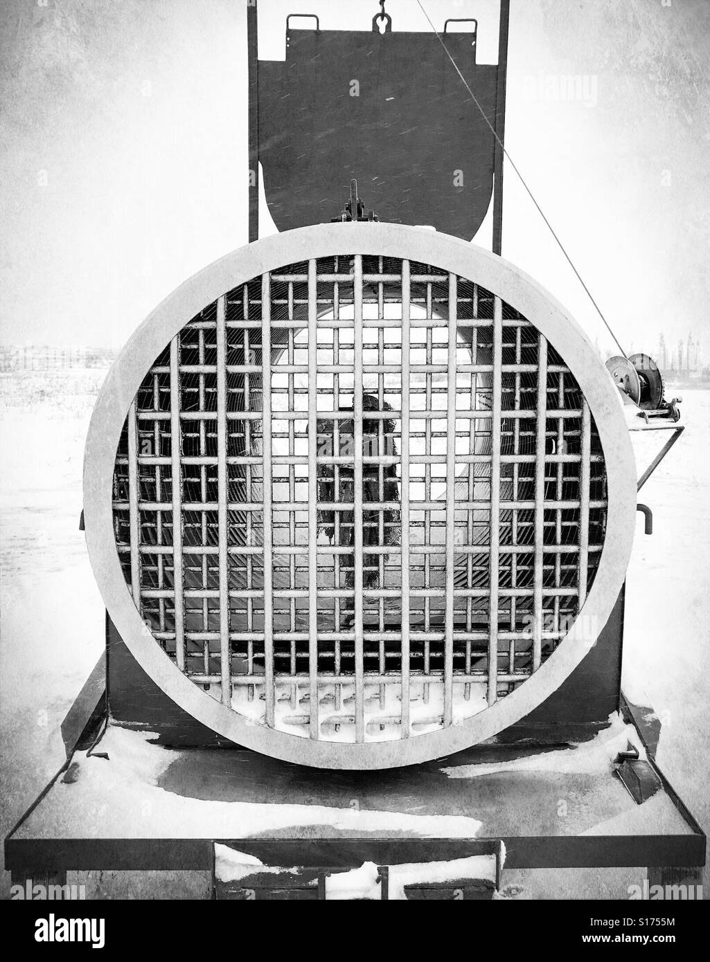 a polar bear trap, baited with seal-oil-soaked canvas, stands in Churchill, Canada. - Stock Image