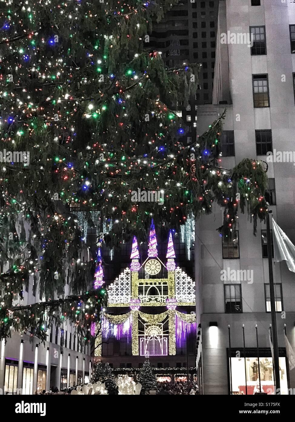 christmas tree and saks fifth avenue light show at rockefeller center in new york city - Rockefeller Christmas Show