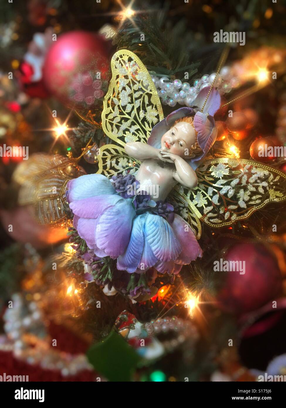 A Pretty Ballerina Angel Tree Ornament On A Colorful Christmas Tree