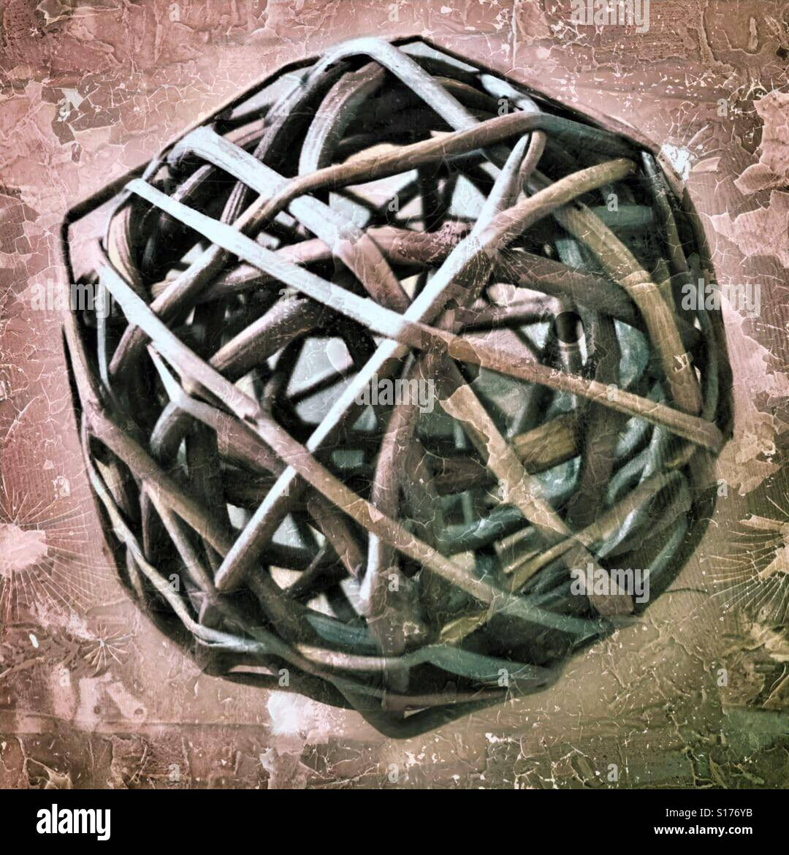 Tangled wicker ball - Stock Image