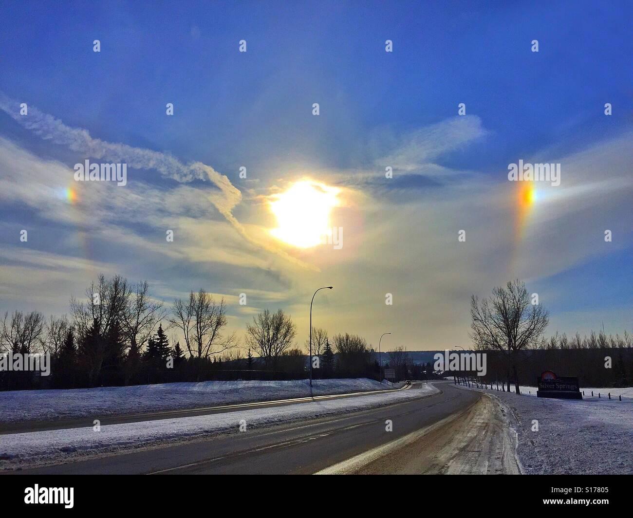 Bright sun,sun dogs, and jet stream - Stock Image