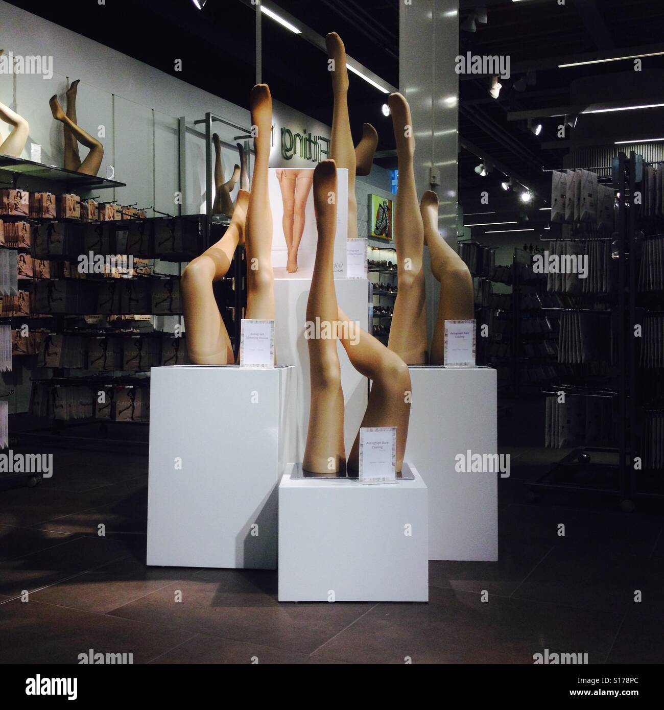 416c84699c8 Upside down Mannequin legs modelling tights in a shop - Stock Image
