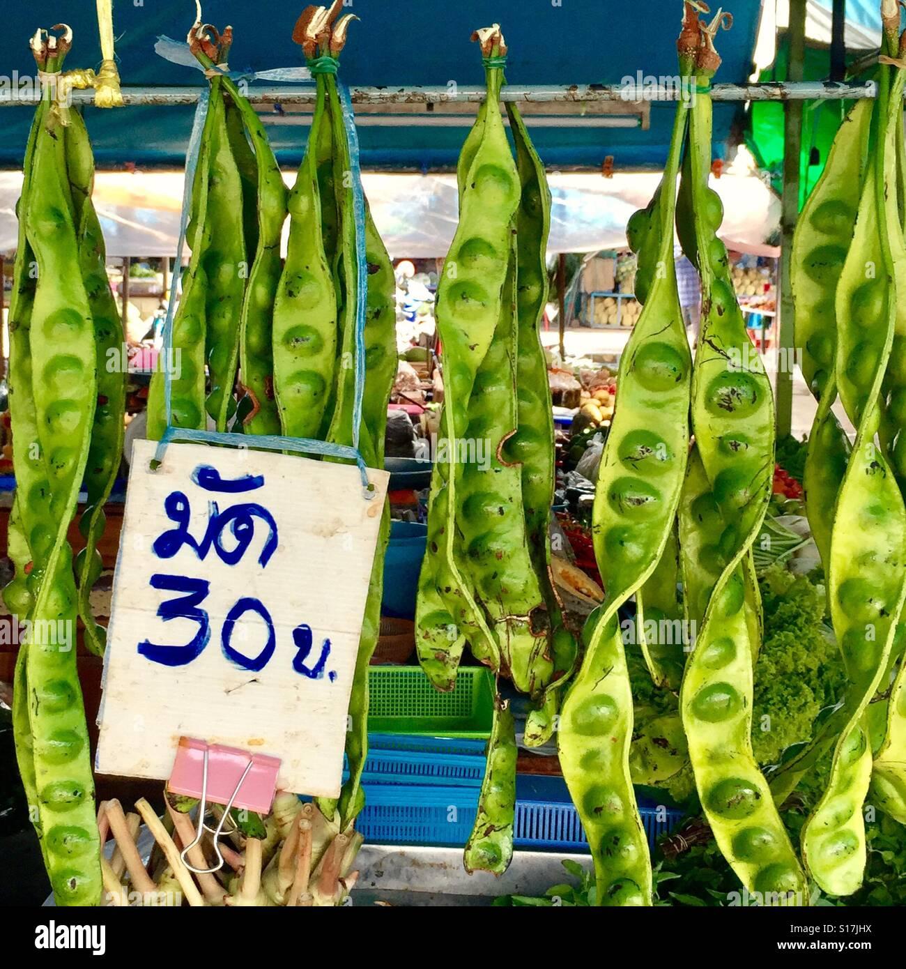 Stinking beans selling at local Thai market, Phuket Old Town,Thailand Stock Photo