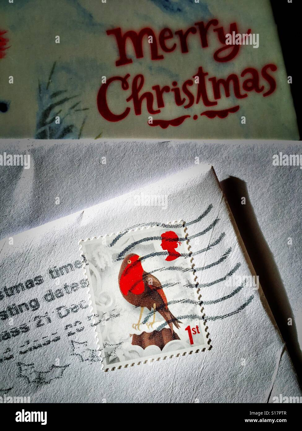 Royal Mail 1st class Christmas stamp and Xmas card UK - Stock Image