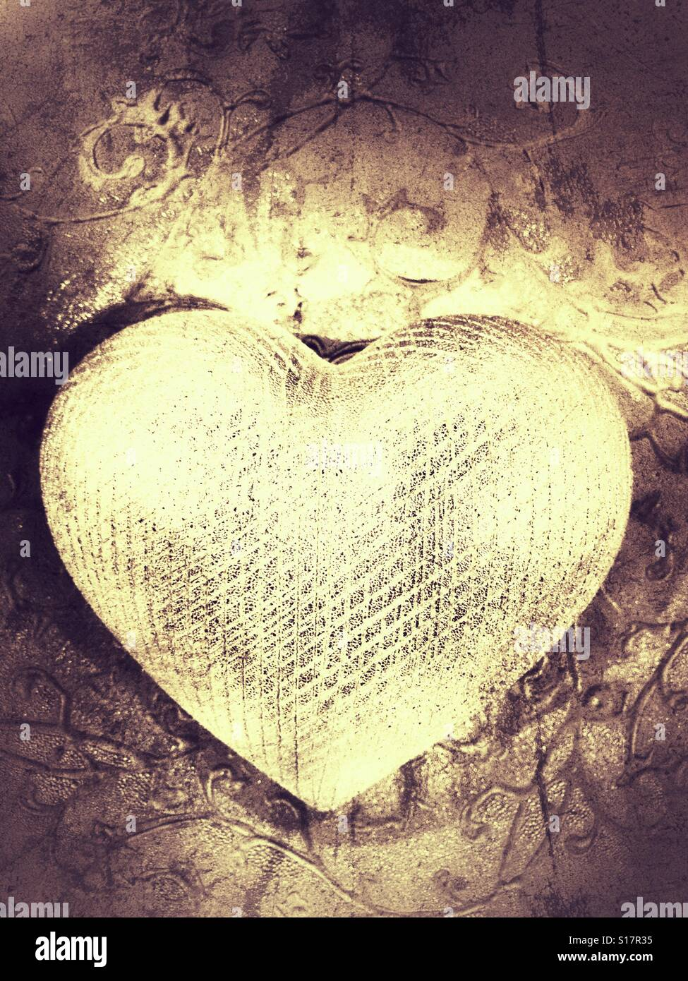 Gold grudge heart - Stock Image