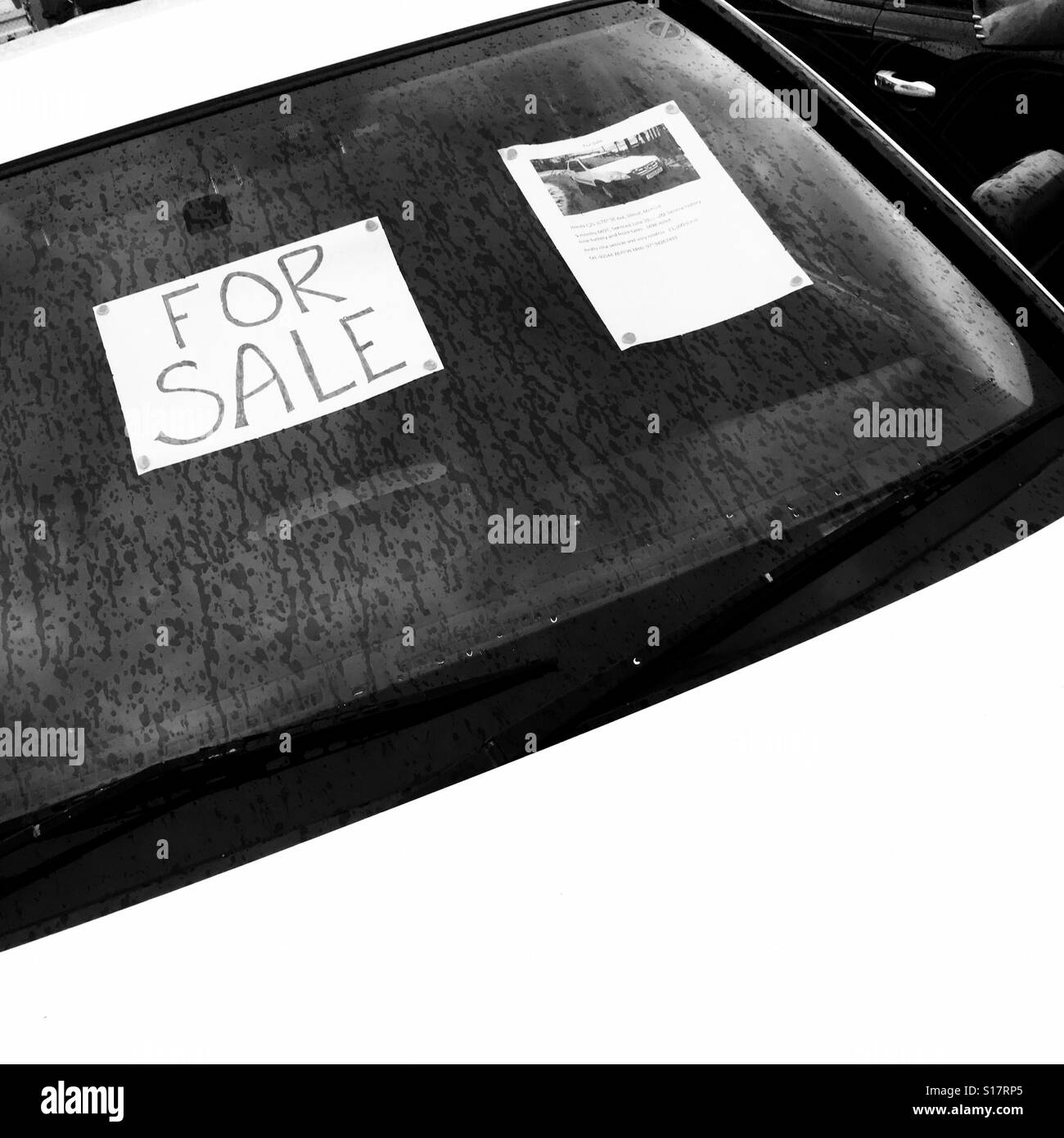 Secondhand car for sale with handmade sign - Stock Image