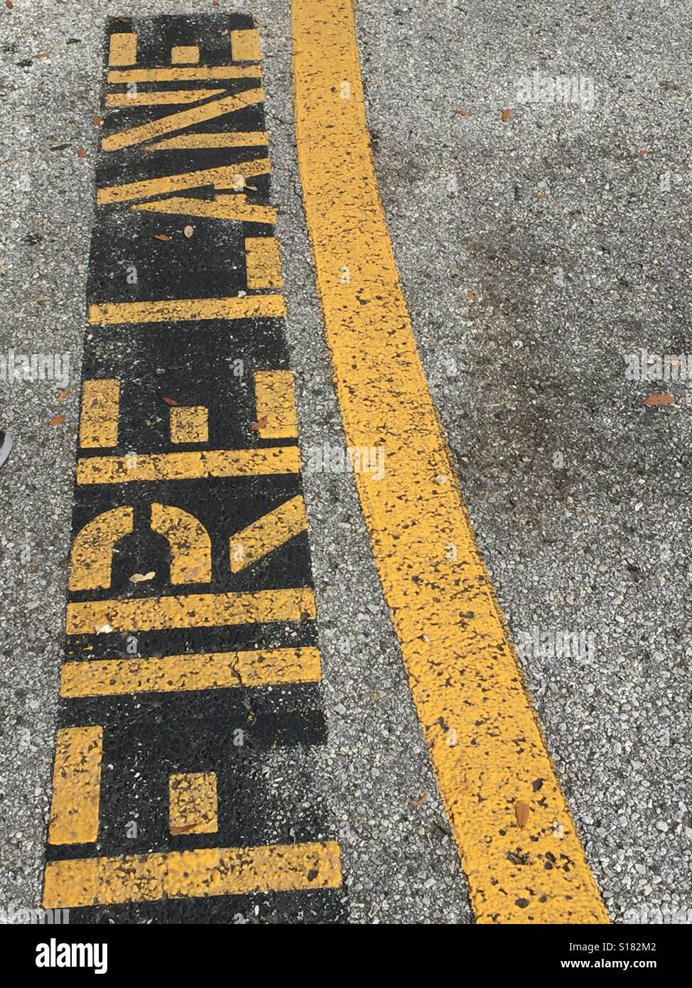 Fire lane painted in yellow letters on the road - Stock Image
