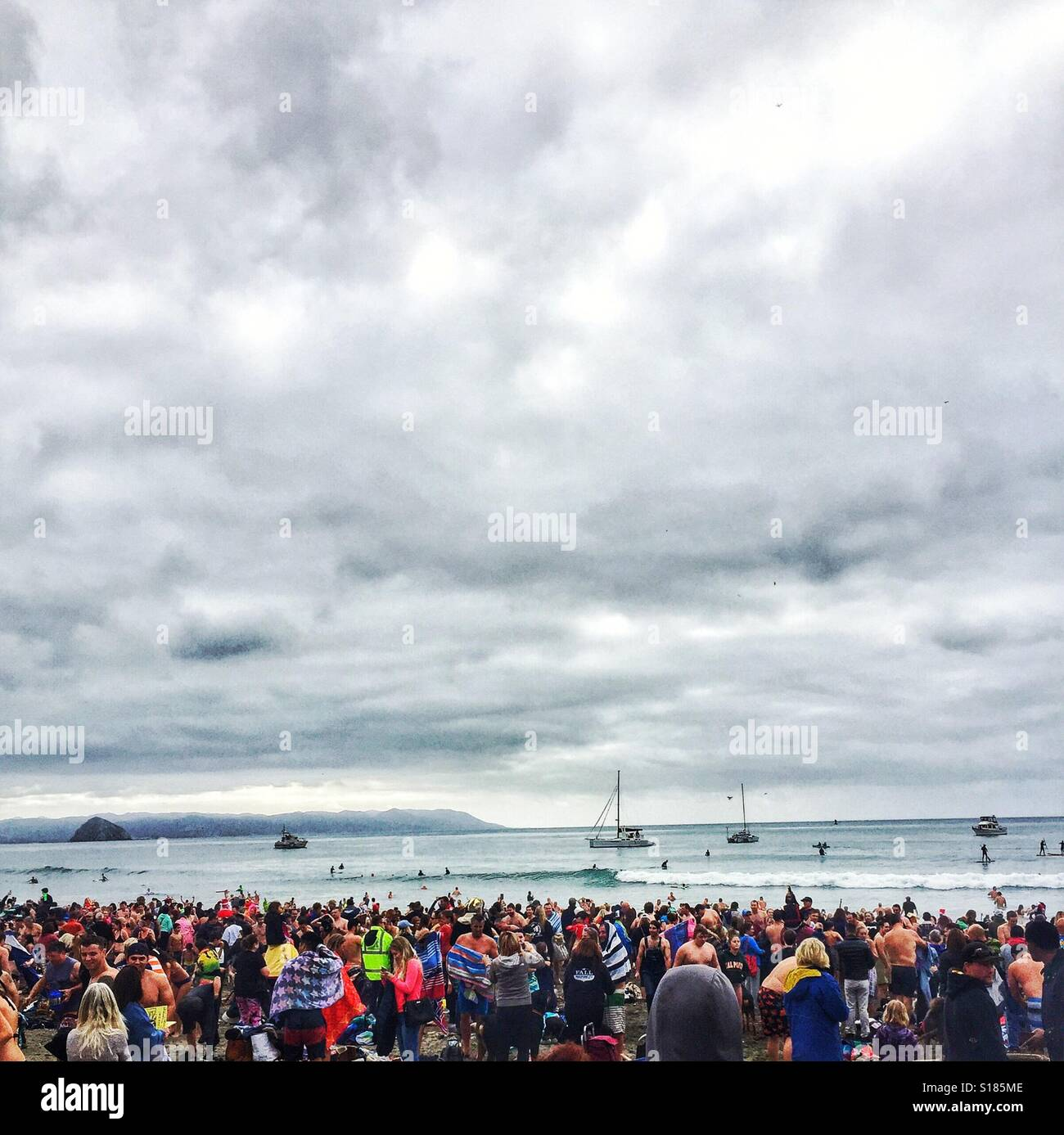 Polar Bear Plunge in Cayucos California...New Year's day 2017...coldest water temperatures on record...down - Stock Image