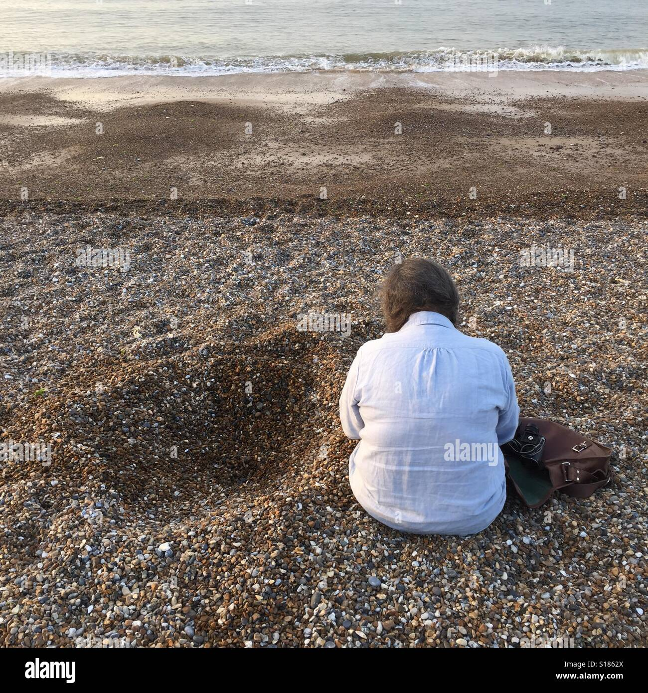 Contemplation on the beach - Stock Image